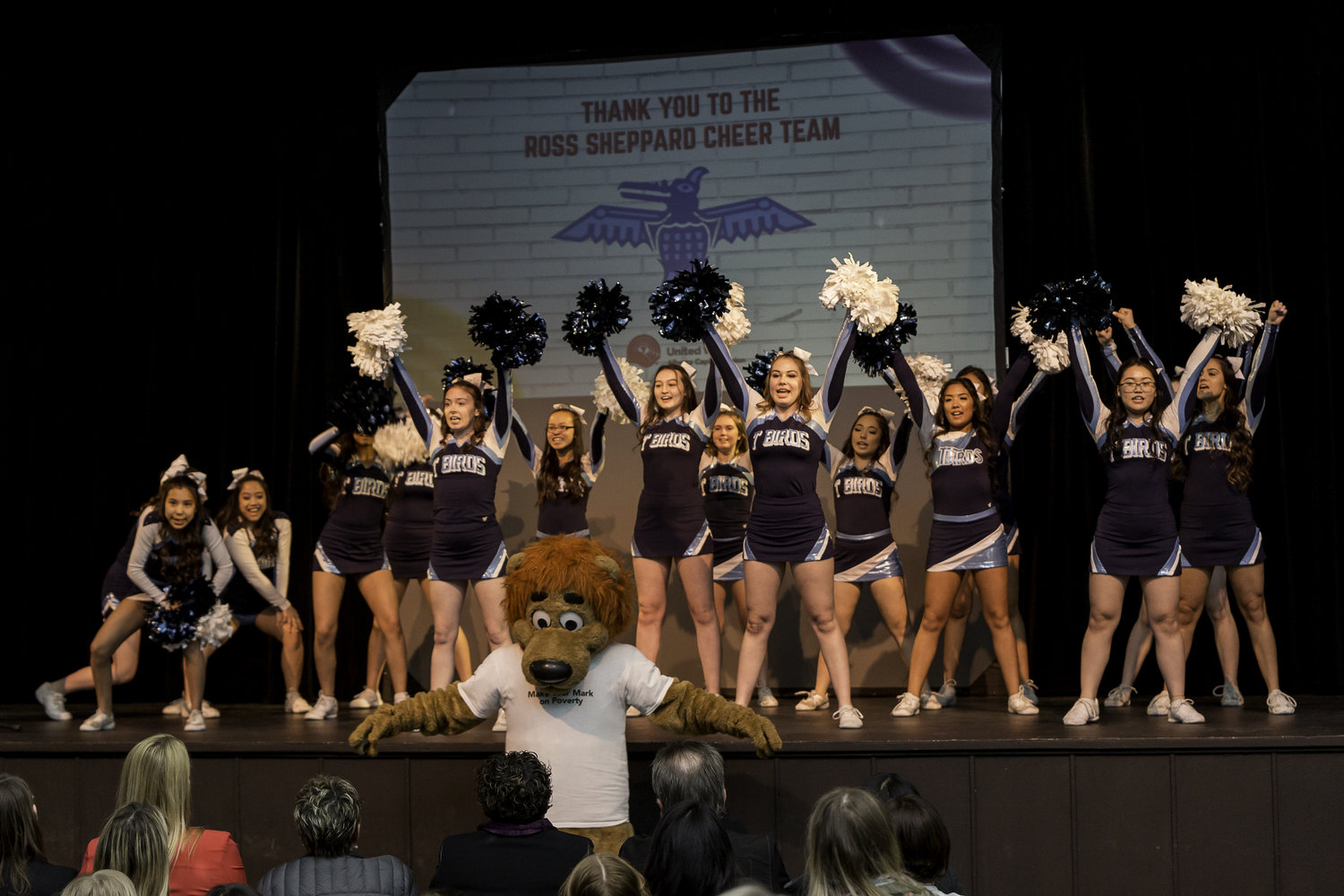 a cheer leading team on a stage with Roary performing a routine