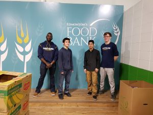 Tokunbo and his youth pose at Edmonton's Food Bank