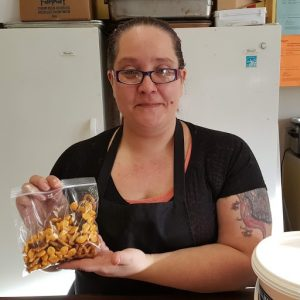 a woman shows off nutritious school snacks