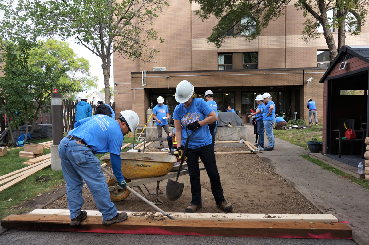engineers work on widening sidewalks for day of caring